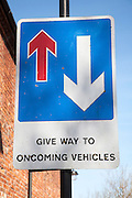 Road sign with arrows Give Way to Oncoming Vehicles, UK