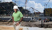 Portrait of a power plant manager in front of a construction site