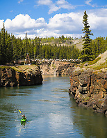 """Whitehorse, Yukon, is aptly referred to as 'The Wilderness City"""". A moment of solitude can be easy to find at Miles Canyon."""