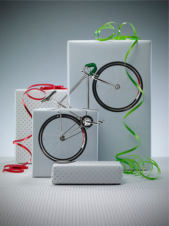 Boxes with with ribbons on top and a bike across the front. Ray Massey is an established, award winning, UK professional photographer, shooting creative advertising and editorial images from his stunning studio in a converted church in Camden Town, London NW1. Ray Massey specialises in drinks and liquids, still life and hands, product, gymnastics, special effects (sfx) and location photography. He is particularly known for dynamic high speed action shots of pours, bubbles, splashes and explosions in beers, champagnes, sodas, cocktails and beverages of all descriptions, as well as perfumes, paint, ink, water – even ice! Ray Massey works throughout the world with advertising agencies, designers, design groups, PR companies and directly with clients. He regularly manages the entire creative process, including post-production composition, manipulation and retouching, working with his team of retouchers to produce final images ready for publication.