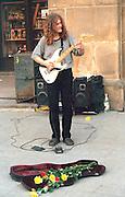 Street musician age 25 playing guitar outside.  Krakow Poland