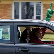 Music teacher Melissa Mason drives down Frampton Drive during a parade of teachers and staff from Beverly Elementary School through the neighborhood in Toledo on Monday, March 23, 2020. There were 34 cars in the parade. THE BLADE/KURT STEISS