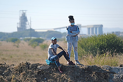 RUSTENBURG SOUTH AFRICA - MAY 18: A couple who formed part of a group of protesters from the Seraleng mining community in Rustenburg, South Africa. Seraleng residents gathered at Sibanye k5 mine shaft Communities in the area alleged complaints of food parcel corruption by a local ward councillor. Grievances also included concerns with unemployment, loss of business and access to a social labour plan. (Photo by Gallo Images/Dino Lloyd)