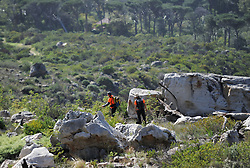 South Africa - Cape Town - 7 July 2020 - Just before midnight on Monday evening WSAR was alerted to a vehicle which was parked on Lower Tafelberg Road. The user of that vehicle's friends had raised the alarm that this trail runner may be on Table Mountain. Members of WSAR got together and they in conjunction with the overdue person's friends decided to do a search of the contour path and the path down to the blockhouse. A vehicle also drove the road towards the block house. Weather conditions were not good. Shortly after midnight the teams the family reported that the missing person' s cellphone appeared to be on the Clifton side of Lion's Head. Further searchers moved up from a temporary base at Nettleton Road. The search on that side had no result. Fresh searches were done on the contour path. The teams stood down just before 04:00 on Tuesday morning. The search was resumed this morning with 5 teams out. The Dept of Health/ AMS helicopter has joined the search which is being co-ordinated from a command post close to the lower cable station. Photographer: Armand Hough/African News Agency(ANA)