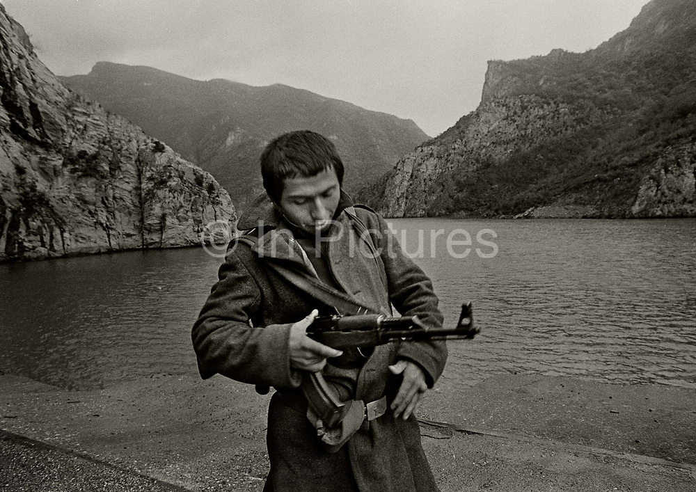 Soldier guarding the landing stage of the Koman Ferry to Bajram Curri. In order to maintain it's political control, the Albanian Communist Party use an army conscription system, enlisting in the Armed Forces personnel dedicated to the military career from the Albanian rural areas, a category of people easily manipulated and subjected to political brainwashing.