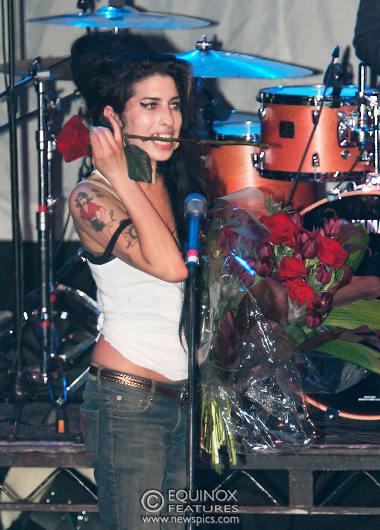 Singer Amy Winehouse, DOB=14/09/1983, performing for her gay fans at the G-A-Y Club. G-A-Y is London's biggest gay club and is held at the London Astoria nightclub, Soho, London, UK. Amy spent much of the show rubbing her itchy nose. She also seemed to have signs of old scars all down one arm...Picture Data:.Photographer: Edward Hirst.Copyright: ©2007 Licensed to Equinox News Pictures +448700 780000.Contact: Equinox Features.Date Taken: 20070415.Time Taken: 020124+0000.www.newspics.com