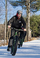 """Kale Poland leads a """"lunch hour"""" workout with Sonya Misiaszek at Gunstock Nordic on Thursday afternoon.  (Karen Bobotas/for the Laconia Daily Sun)"""