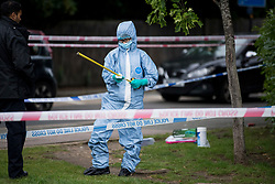 © Licensed to London News Pictures. 09/07/2020. London, UK. Police forensics examine the scene near Seeley Drive in West Dulwich, South London where a man, believed to be aged 18, was found stabbed to death on Wednesday evening. Photo credit: Ben Cawthra/LNP