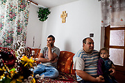 "David Korckovsky with his father and the daughter of his sister at the house of his parents .David grew up at the Roma settlement ""Podsadek"" and he is the first Roma from the settlement who made it to University and finished in 2016 social work with a MA degree."