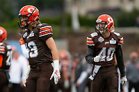 KELOWNA, BC - SEPTEMBER 8:   Liam Johnstone #40 stands on the field with Cole Stregger #19 of Okanagan Sun against the Langley Rams at the Apple Bowl on September 8, 2019 in Kelowna, Canada. (Photo by Marissa Baecker/Shoot the Breeze)