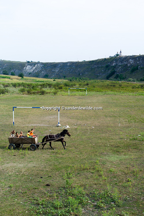 Old Orhei Moldova, is the place where our ancestors lived, and where you can visit underground monastry caves, or just see boys in a horse and carriage have lots of fun, with the monastray and caves in the background.