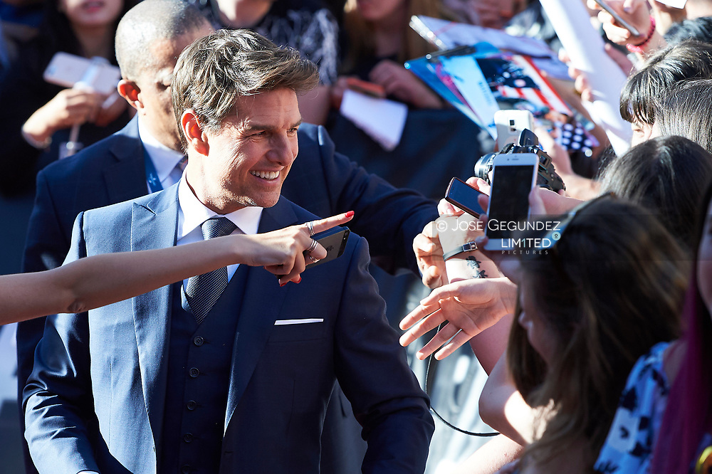 Tom Cruise signs autographs during 'The Mummy' film premiere at Callao Cinema on May 29, 2017 in Madrid