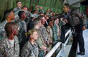 U.S. President Barack Obama meets with troops at Bagram Air Base in Kabul, March 28, 2010.   <br /> REUTERS/Jim Young