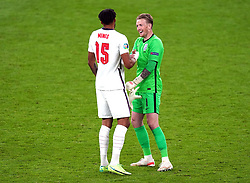 England's Tyrone Mings (left) and goalkeeper Jordan Pickford celebrate after the final whistle during the UEFA Euro 2020 Group D match at Wembley Stadium, London. Picture date: Tuesday June 22, 2021.