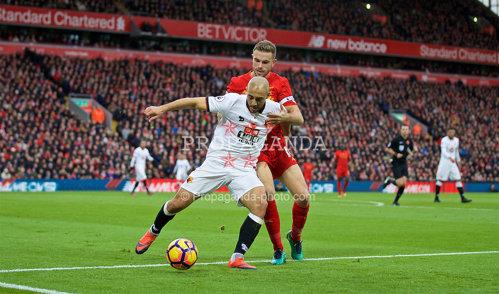 LIVERPOOL, ENGLAND - Sunday, November 6, 2016: Watford's Younes Kaboul and Liverpool's captain Jordan Henderson during the FA Premier League match at Anfield. (Pic by David Rawcliffe/Propaganda)