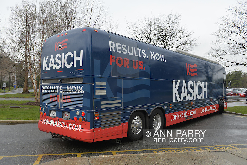 "Hempstead, New York, USA. April 4, 2016. The John Kasich Campaign Bus, with slogan ""RESULTS. NOW. FOR US.' on side, is leaving campus, after the Republican presidential candidate and governor of Ohio, hosted a Town Hall at Hofstra University David Mack Student Center in Long Island. The New York primary is April 19, and Kasich is the first of the three GOP presidential candidates to campaign in Nassau and Suffolk Counties, and is in third place in number of delegates won."