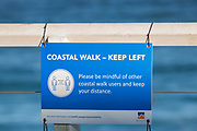 Sydney, Australia. Sunday 3rd May 2020. Coastal warning sign to social distance during the coronavirus pandamic at Bronte Beach in Sydney's eastern suburbs.