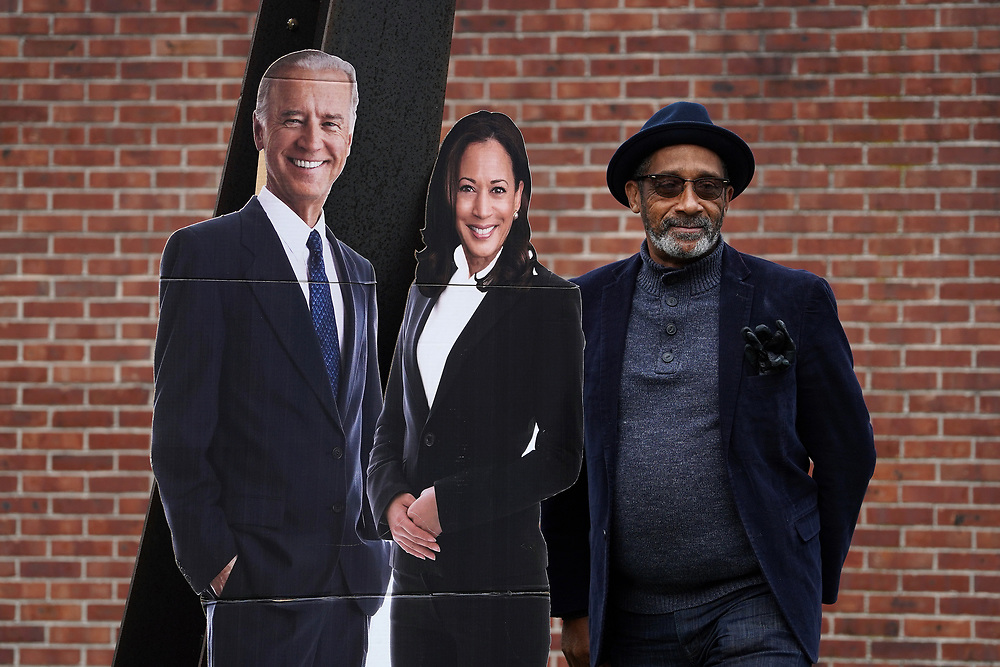 """An attendee poses with cutouts of Joe Biden and Kamala Harris as United Steelworkers Local 2599 hosted a """"Ridin' 4 Biden Ticket Caravan"""" on Oct. 25, 2020, in Bethlehem, Northampton County, Pennsylvania. Northampton County is a crucial region for Presidential candidates looking to win Pennsylvania as the county went for Obama in 2012 and then for Trump in 2016. (Photo by Matt Smith)"""