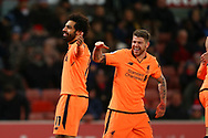 Mohamed Salah of Liverpool (l) celebrates with teammate Alberto Moreno after scoring his teams 3rd goal. Premier league match, Stoke City v Liverpool at the Bet365 Stadium in Stoke on Trent, Staffs on Wednesday 29th November 2017.<br /> pic by Chris Stading, Andrew Orchard sports photography.