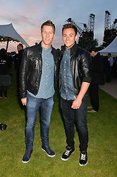 Left to right, DUSTIN LANCE BLACK and TOM DALEY at the Battersea Power Station Annual Party at Battersea Power Station, 188 Kirtling Street, London SW8 on 30th April 2014.