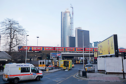 © Licensed to London News Pictures. 16/01/2013. London, UK. Fire engines and a cordon are seen near Vauxhall in London today (16/01/13) after a helicopter crashed into a crane attached to a high rise building (in background). Photo credit: Matt Cetti-Roberts/LNP