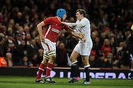 England's Alex Goode gets to grips with Justin Tupuric of Wales.RBS Six nations championship 2013, Wales v England at the Millennium stadium in Cardiff , South Wales on Saturday 16th March 2013. pic by Andrew Orchard, Andrew Orchard sports photography,