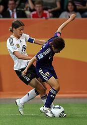 09.07.2011, Arena im Allerpark Wolfsburg , Wolfsburg ,  GER, FIFA Women Worldcup 2011, Viertelfinale ,   Germany (GER) vs Japan (JPN) im Bild.Kerstin Garefrekes (GER) gegen Yukari Kinga (JPN) .  //  during the FIFA Women Worldcup 2011, Quarterfinal, Germany vs Japan  on 2011/07/09, Arena im Allerpark , Wolfsburg, Germany.  .EXPA Pictures © 2011, PhotoCredit: EXPA/ nph/  Hessland       ****** out of GER / CRO  / BEL ******