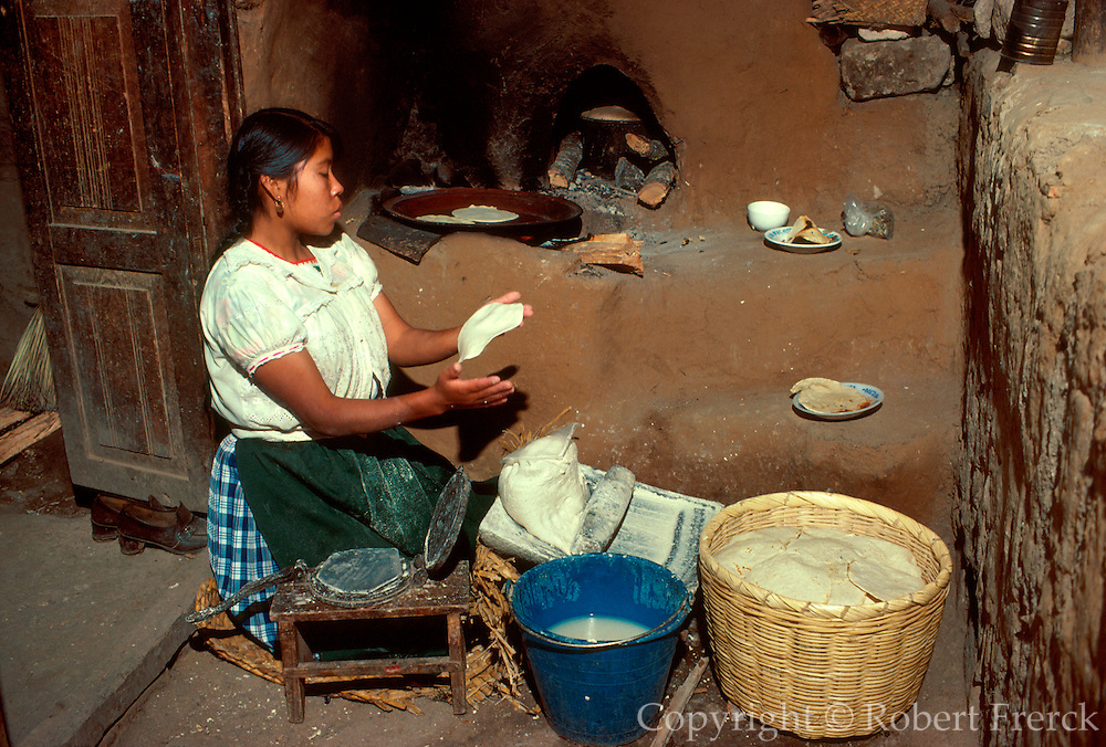 MEXICO, PEOPLE, VILLAGES Making tortillas on Janitzio Island in Lake Patzcuaro, Michoacan