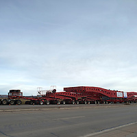 A truck carrying a 1.5 million pound transfermer sits on the side of Highway 491near Twin Lakes, Wednesday, waiting for New Mexico Department of Transportation to help move the heavy load through the contraction zone in Tohatchi.