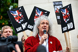 © Licensed to London News Pictures. 14/07/2015. London, UK. Brian May and animal rights campaigners protesting against government plans to bring back fox hunting, ahead of the vote in the House of Commons on Tuesday, July 14, 2015 outside House of Parliament in London. Photo credit: Tolga Akmen/LNP