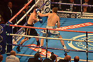 Sam Eggington lands a left hook on the side of Glenn Foot head during the High Stakes Matchroom Boxing at the Manchester Arena, Manchester, United Kingdom on 18 July 2015. Photo by Mark Pollitt.