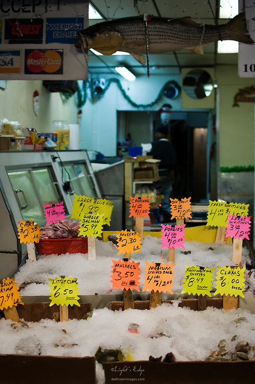Various iced seafood choices await potential custumers at a seafood vendor's operation in The Italian Market in Philadelphia, PA.