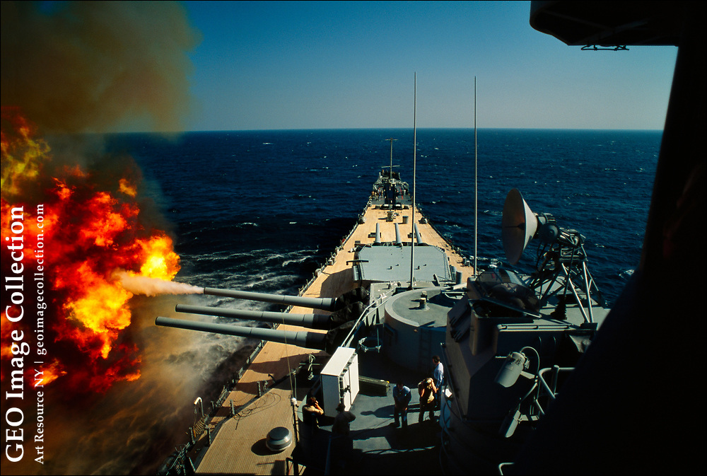The American battleship U.S.S. Wisconsin unleashes its 16-inch guns against the Iraqi Army in Kuwait during the openings days of Operation Desert Storm, sometimes called the Persian Gulf War of 1990-1991.  Iraq occupied Kuwait in in 1990 and was ultimately ejected from the tiny Persian Gulf nation by an international coalition from 32 nations, including the United States, Britain, Egypt, France, Saudi Arabia, and Kuwait.
