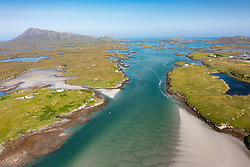 Aerial view from drone of coastal landscape on  Benbecula with Eaval mountain on the left in the Outer Hebrides, Scotland, UK