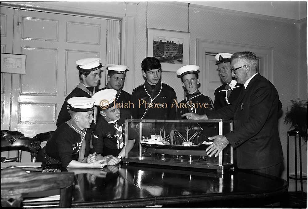 """02/06/1964 <br /> 06/02/1964<br /> 02 June 1964<br /> Sea Scouts at Palgrave Murphy Shipping Ltd., Eden Quay, Dublin. The Scouts examine a model of the """"City of Dublin"""". Palgrave Murphy named their ships after ports.  Mr. C.M. Grace, Engineer Superintendent, Palgrave Murphy Shipping Ltd. is on the right."""
