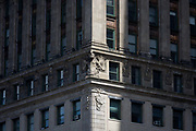 Detailed corner of 19th century carving stonework architecture in Manhattan, New York City. High-rise buildings are mostly corporate offices though some apartments in this, one of the world's great megacities. They occupy addresses along Broadway - a mixture of modernity and 19th century architecture can be seen in detail.