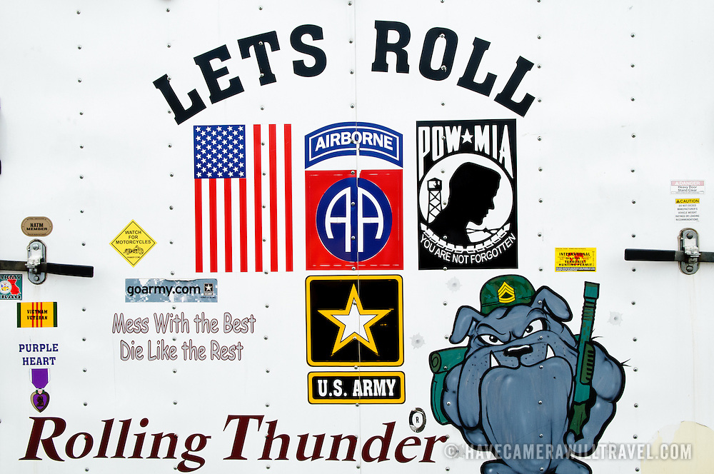Signs and symbols on the back of an organizer's truck at the annual Rolling Thunder motorcycle rally through downtown Washington DC on May 29, 2011. This shot was taken as the riders were leaving the staging area in the Pentagon's north parking lot, where thousands of bikes and riders had gathered.