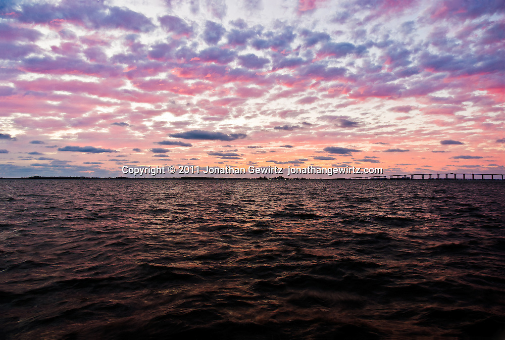 Predawn twilight with a dramatic sky over Virginia Key, the William Powell bridge and the Rickenbacker Causeway in Biscayne Bay. WATERMARKS WILL NOT APPEAR ON PRINTS OR LICENSED IMAGES.