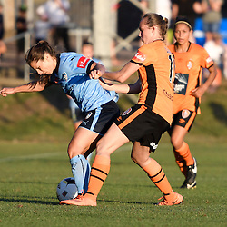 BRISBANE, AUSTRALIA - OCTOBER 30: Abbey Lloyd of the Roar and Servet Uzunlar of Sydney compete for the ball during the round 1 Westfield W-League match between the Brisbane Roar and Sydney FC at Spencer Park on November 5, 2016 in Brisbane, Australia. (Photo by Patrick Kearney/Brisbane Roar)