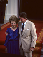 President Ronald Reagan hugs First Lady Nancy Reagan at the North Portico of the White House in June 1981..Photograph by Dennis Brack bb23