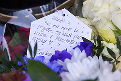 © Licensed to London News Pictures. 22/05/2018. Manchester UK. Picture shows flowers left in St Ann's Square in Manchester this morning to mark the first anniversary of the Manchester Arena bombing. 22 people died when Salman Abedi detonated a bomb at an Ariana Grande concert. Photo credit: Andrew McCaren/LNP