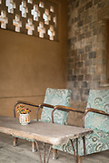 Armchairs and vase with flowers on table, Pigs Inn, Bishan, Anhui Province, China