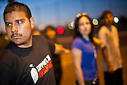 """Sept. 19 - PHOENIX, AZ: JOSHUA MONTANA drills behind US Sen. John McCain's office in Phoenix Sunday night. About 30 people met in front of US Sen. John McCain's office in Phoenix Sunday night to demonstrate in support of the DREAM Act, which is scheduled to be debated in the US Senate on Tuesday, Sept 21. The Development, Relief and Education for Alien Minors Act (The """"DREAM Act"""") is a piece of proposed federal legislation in the United States that was introduced in the United States Senate, and the United States House of Representatives on March 26, 2009. This bill would provide certain illegal immigrant students who graduate from US high schools, who are of good moral character, arrived in the U.S. as minors, and have been in the country continuously for at least five years prior to the bill's enactment, the opportunity to earn conditional permanent residency. In the early part of this decade McCain supported legislation similar to the DREAM Act, but his position on immigration has hardened in the last two years and he no longer supports it. The protesters, mostly area students, marched and drilled to show their support for the US military and then held a candle light vigil.   Photo by Jack Kurtz"""