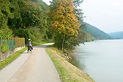 Cycling on the Danube bicycle Path between  Passau Germany and Schlogener Austria Model release available