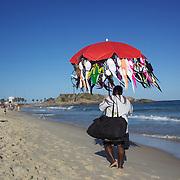 A bikini seller on Ipanema beach, Rio de Janeiro,  Brazil. 4th July 2010. Photo Tim Clayton..