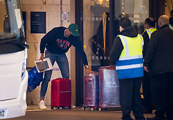 © Licensed to London News Pictures. 15/02/2021. London, UK. Security guards watch as the first passengers to go into hotel quarantine arrive at a Radisson hotel near Heathrow Airport. People entering the UK from a 'red list' of 33 high risk countries will have to quarantine at hotels for 10 days to try and stop new coronavirus variants entering the country. Photo credit: Peter Macdiarmid/LNP