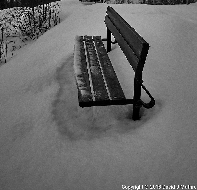 Lonely bench in the snow. Trondheim overlook. Image taken with a Nikon 1 V2 camera and 10 mm f/2.8 lens (ISO 800, 10 mm, f/2.8, 1/60 sec).