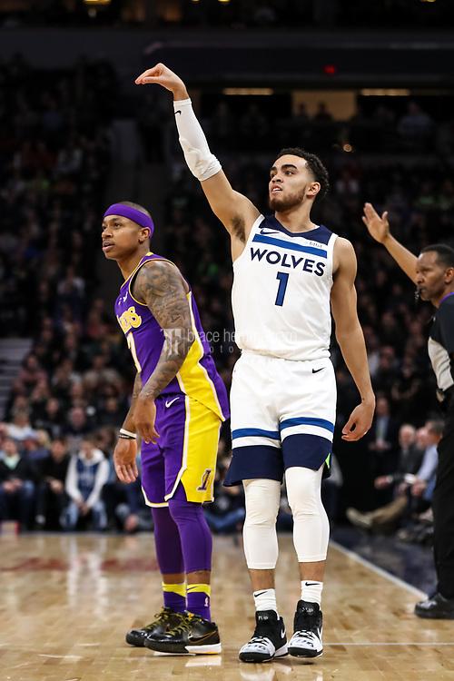 Feb 15, 2018; Minneapolis, MN, USA; Minnesota Timberwolves guard Tyus Jones (1) shoots over Los Angeles Lakers guard Isaiah Thomas (7) at Target Center. Mandatory Credit: Brace Hemmelgarn-USA TODAY Sports