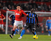 20120131: MANCHESTER, UK - Barclays Premier League 2011/2012: Manchester United vs Stoke City.<br /> In photo: Kenwynne Jones of Stoke City challenged by Park Ji-Sung of Manchester United.<br /> PHOTO: CITYFILES