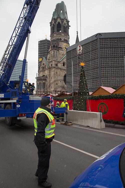 """Berlin, Germany - 22.12.2016<br /> <br /> After a memorial service in the Gedaechniskirche on the Breitscheidplatz, the Christmas market will be reopened on the third day after the terrorist attack under sharp security precautions. On the 19th of december a truck drove into the Berlin Breitscheidplatz Christmas market on. Twelve people died and 49 people were injured. The so called terror group """"Islamic State"""" claim responsibility for the attack.<br /> <br /> Nach einer Gedenk-Andacht in der Gedaechniskirche auf dem Breitscheidplatz wird der Weihnachtsmarkt am 3. Tag nach dem Terroranschlag unter scharfen Sicherheitsvorkehrungen wiedereroeffnet. Am 19. Dezember fuhr ein LKW in den Breitscheidplatz Weihnachtsmarkt - 12 Menschen starben und 49 wurden verletzt. Die sogenannte Terrorgruppe """"Islamischer Staat"""" bekannte sich inzwischen zu dem Anschlag.<br /> <br /> <br /> <br /> Photo: Bjoern Kietzmann"""